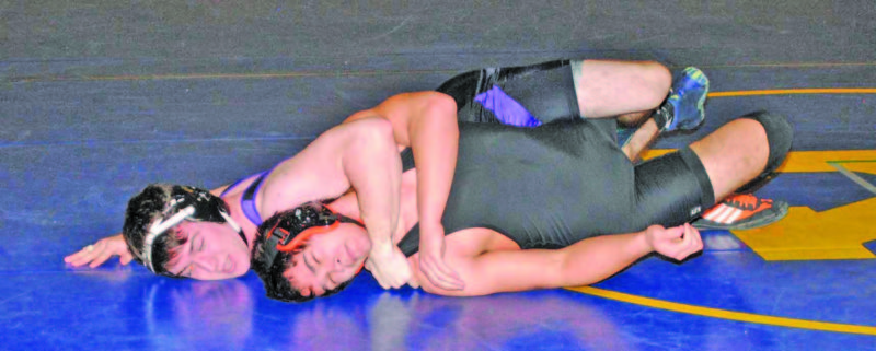Burt Angeli | The Daily News Photos Gladstone's Alex Chouinard decisioned Munising's Christian Cole 3-0 for the 160-pound title Saturday in the 18th annual Ray Mariucci Invitational at Kingsford High School.