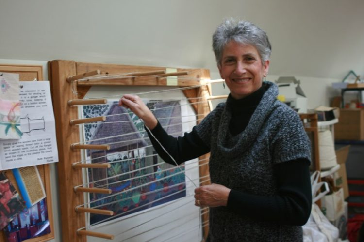 Courtesy photo Carol Irving strings a loom.