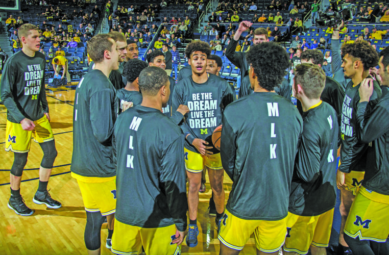 AP photo Michigan guard Jordan Poole, center, leads teammates in a huddle during warmups before Monday's  game against Maryland. Michigan wore special warmup tees honoring Martin Luther King Jr.