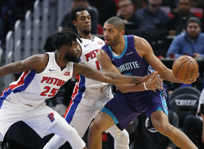 AP photo Detroit Pistons forward Reggie Bullock (25) fouls Charlotte Hornets guard Nicolas Batum (5) as Pistons guard Ish Smith, center, helps defend the basket during the first half Monday in Detroit.