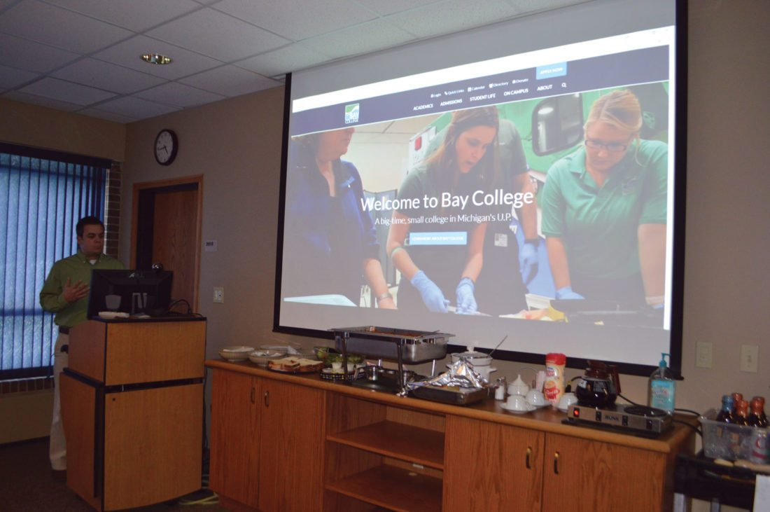 Jordan Beck | Daily Press Bay College Digital and Web Tech Specialist Shawn Curtin shows the Bay College Board of Trustees an early version of the college's redesigned website during its meeting Wednesday.
