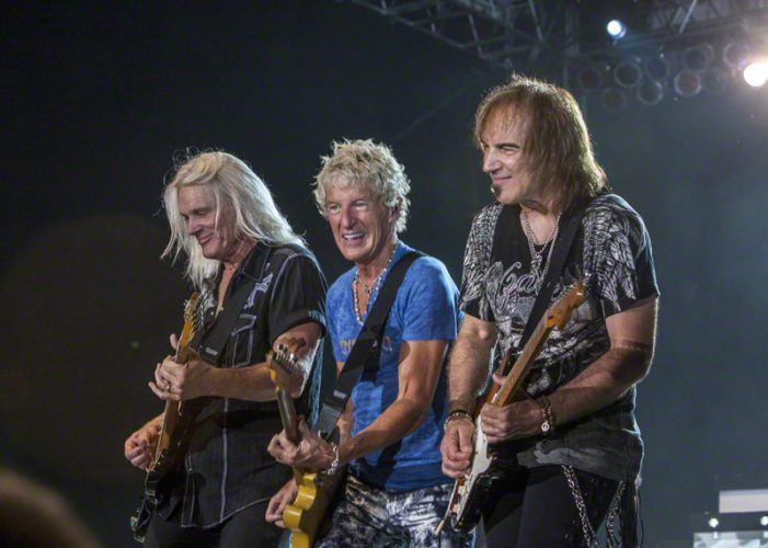Photo by Larry Philpot, www.soundstagephotography.com, via Wikicommons Above, REO Speedwagon members Bruce Hall, Kevin Cronin, and Dave Amato perform in Indianapolis in 2011. Thirteen performances were postponed this year including two at the Island Resort and Casino in Harris due to Cronin requiring robotic surgery.