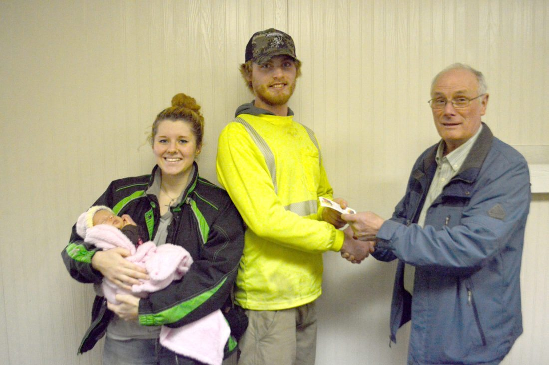 Ilsa Matthes | Daily Press Kevin Dubord, right, deputy grand knight of the Knights of Columbus, Escanaba Council 640, presents a $250 gift card for Elmer's County Market to Paula Hanskett-Nolan and Austen DeBacker. DeBacker and Hanskett-Nolan are the parents of the first baby born at OSF St. Francis Hospital in 2018, Aria DeBacker (also shown). Aria was born at 12:34 a.m. Wednesday, Jan. 3, weighing 7 pounds, 6.3 ounces. She was 18.5 inches long, and is the couple's first child.