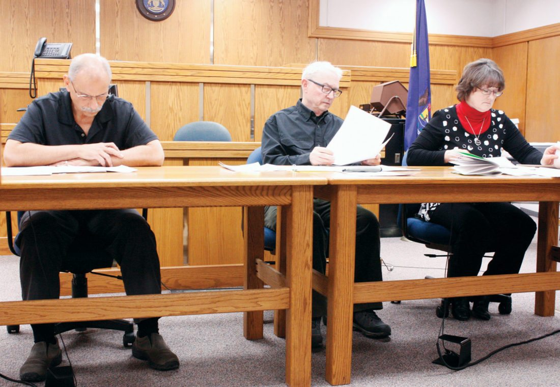Jenny Lancour | Daily Press  Members of the Delta County Election Commission review recall petition wording seeking the removal of elected officials in Fairbanks and Garden townships Thursday. Members of the commission are, from left, Delta County Treasurer Tom Sabor, Delta County Probate Court Judge Robert Goebel Jr. and Delta County Clerk Nancy Kolich.