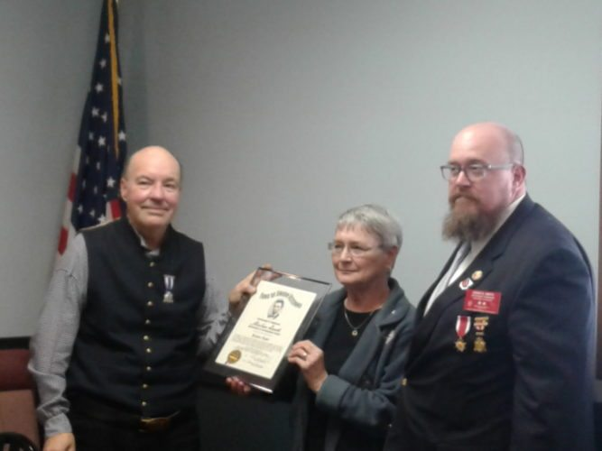 Courtesy photo Jeanne Rose receives the Abraham Lincoln Award from Sons of Union Veterans of the Civil War Immediate Past Camp Commander Paul Silver (right), of Little Lake, and Department of Michigan Commander David W. Smith, of Traverse City.