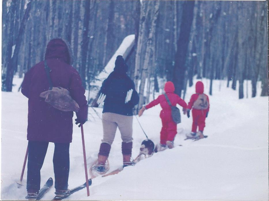Karen Wils photo Heading home. Pictured is the backside of Dad on his wooden skis with my sister and two nephews in front of him.