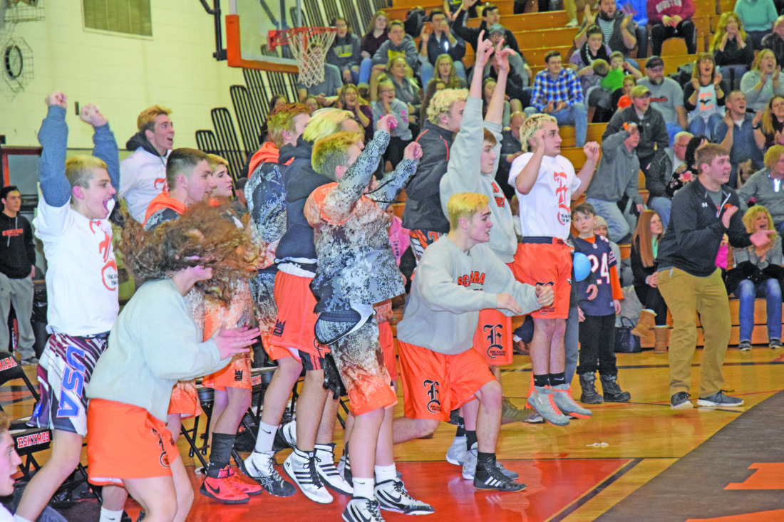 Mike Mattson | Daily Press Members of the Escanaba wrestling team celebrate during Bailey Papineau's 189-pound bout against Gladstone's Darin Johnson.