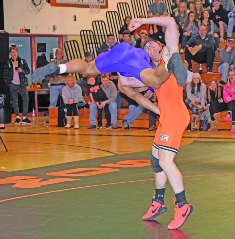 Mike Mattson | Daily Press Gladstone's Darin Johnson, left, and Escanaba's Bailey Papineau hooked up in a  thrilling 189-pound match in Wednesday's dual meet at EHS.