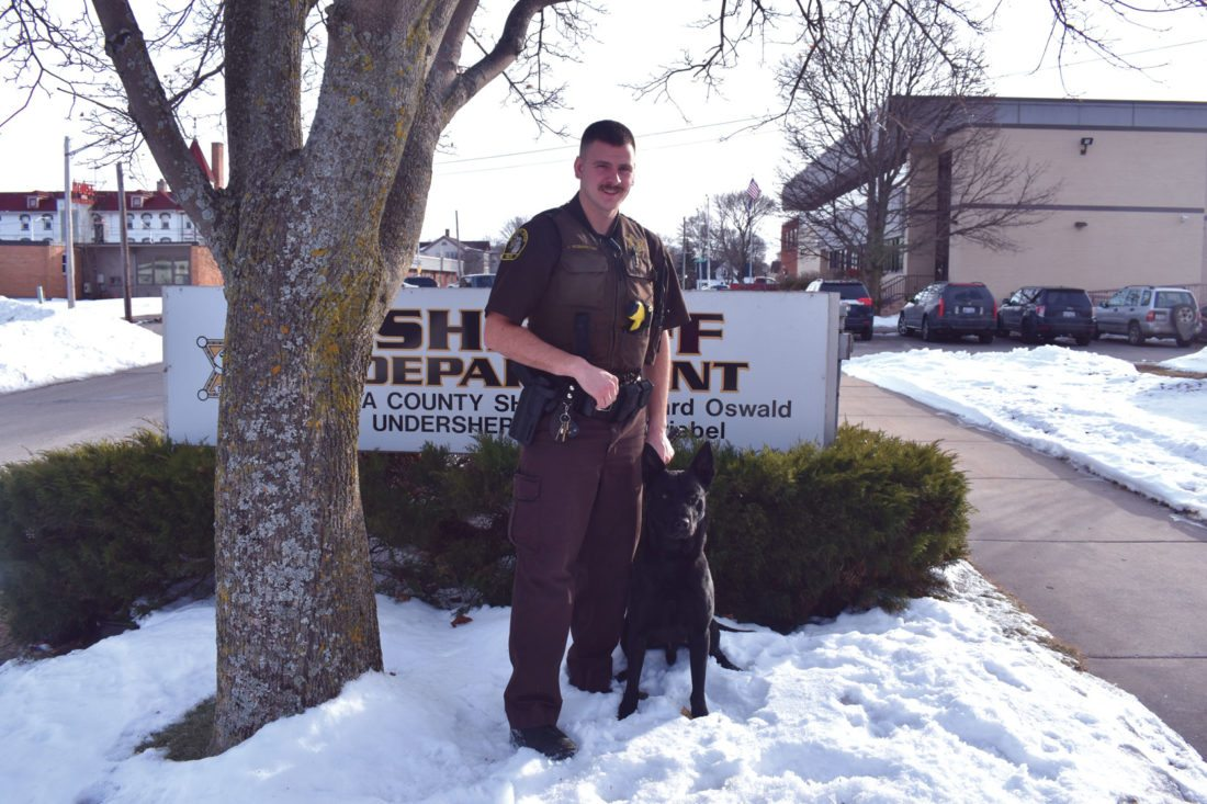 Haley Gustafson | Daily Press  Delta County Sheriff's Deputy James McDonough stands with the K-9 Jet, the department's newest addition, outside of the Delta County Sheriff's Department in Escanaba Tuesday. Since joining the department, McDonough said Jet has been utilized in vehicle searches for narcotics and tracking.