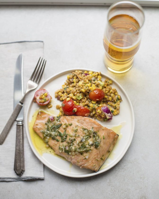 This November 2017 photo shows salmon with a tarragon vinaigrette in New York. this dish is from a recipe by Katie Workman. (Mia via AP)