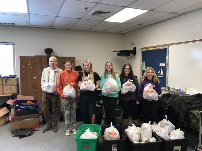 Courtesy photo Members of the Gladstone Key Club fill bags for students in need. From left to right, Dalton Lauerman, Isabelle VanBrocklin, Marnnea LaFave, Megan Robinson, Abigail Micheau, Gabbie Wares are shown. In addition to the students pictured, many other students have been involved with the program.