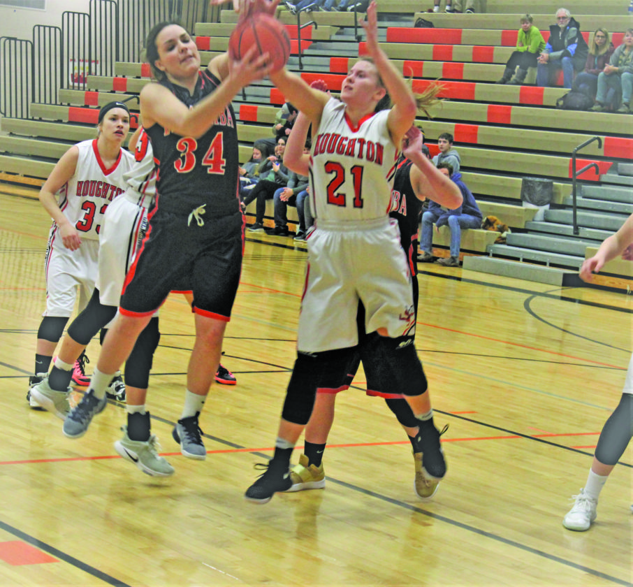 Photo by Paul Peterson Madison Griffin of Escanaba battles for a rebound with Kara Pietila of Houghton Thursday night in Houghton.