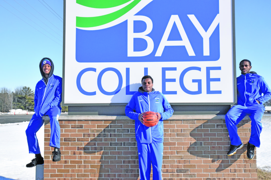 Mike Mattson | Daily Press From left, Alfonzo Fields, Kobi Barnes and Rasonte Smith pose in front of a Bay College sign on a recent warm winter day. The trio opted to leave their big cities and compete for the Norse men's basketball team.