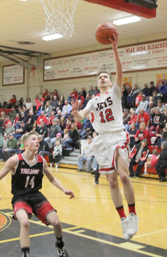 Avery Bundgaard | Daily Press North Central's Noah Gorzinski (12) goes up for a layup on a fastbreak while Forest Park's Josh Logan watches during the first quarter Friday in at North Central.