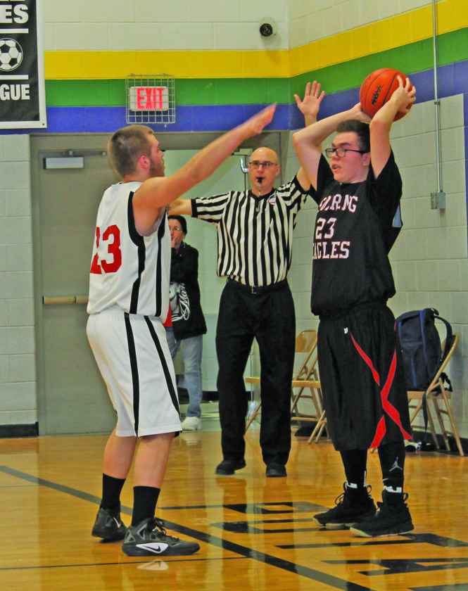 Photo courtesy Mary Gauthier Hannahville's Chad Harris (23) inbounds the ball Saturday against Richard Willis of Ojibwe. Harris and the Soaring Eagles earned a 51-48 victory.