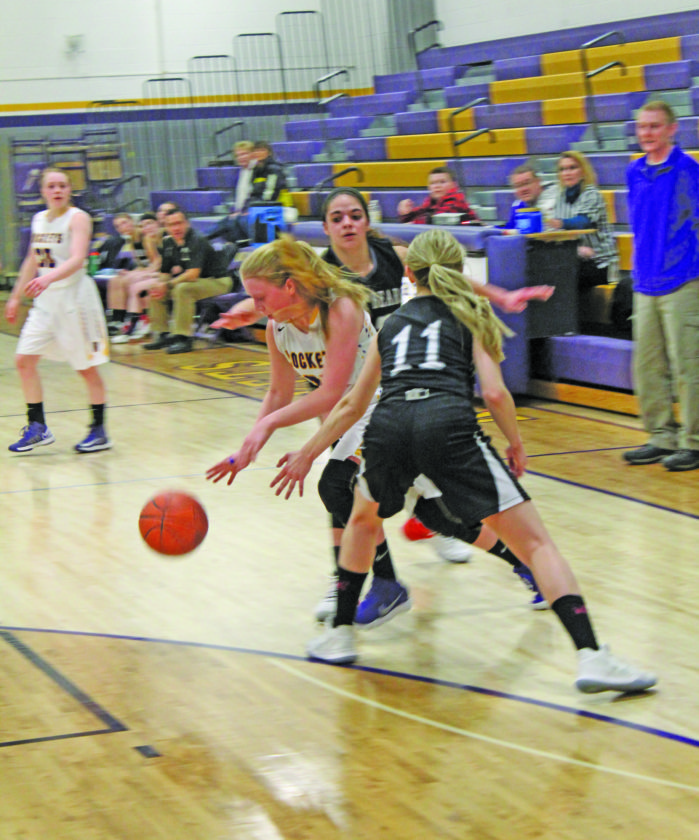 Avery Bundgaard | Daily Press  Rapid River's Elizabeth Goodacre, left, escapes the defense of Big Bay de Noc's Maddie McPhee (11) and Brooke Dalgord, center, during overtime Monday at Rapid River.