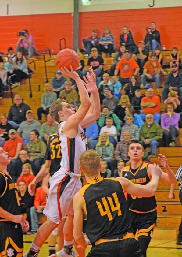 Mike Mattson | Daily Press Escanaba's Craig Kamin launches a shot in the lane Tuesday. Kamin led the Eskymos in scoring with 10 points.