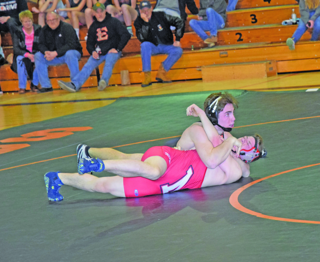 Mike Mattson | Daily Press Escanaba's Scout Wunder gets ready to pin Marquette's Liam Groves in the 160-pound match Wednesday night at EHS.