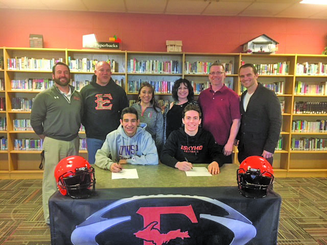Courtesy photo Escanaba's Hayden Haslow and Scout Wunder have signed national letters of intent to play football at the next level. Haslow will attend UW-Stevens Point and Wunder will attend Michigan Tech. Haslow, front left, and Wunder, front right, are pictured at Wednesday's signing. Standing from left are: EHS head football coach Dave Howes, Greg Haslow, Margie Haslow, Polly Wunder, Tim Wunder, and EHS athletic director Nick Nolde.