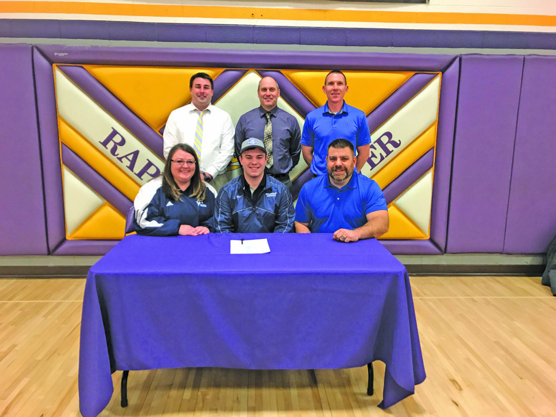 Courtesy photo Rapid River's Jarrett LaCasse signed a national letter of intent Wednesday to play football at Finlandia University. Pictured for the signing in front row with Jarrett are his parents Joanna Thorbahn and Jon LaCasse. Back row from left: Assistant football coach Kurt Almonroeder, head football coach Steve Ostrenga and athletic director Rick Pepin.
