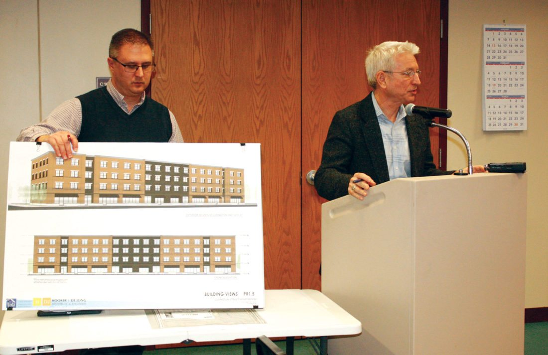 Jenny Lancour | Daily Press Site plans for a four-story, 45-unit apartment and retail complex in downtown Escanaba are presented during Thursday's planning commission meeting by Architect Chad Grinwis, at left, of Hooker/De Jong Architects and Engineers, and Craig Patterson, representing the project's developer, Bay de Noc Limited Dividend Housing Association.