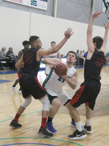 Avery Bundgaard | Daily Press Bay College's Damian Richmond, center, prepares to put up a shot between UW-Fox Valley's Indy Johal, left, and Jason Gurholt, right, during the first half Saturday at Bay College.
