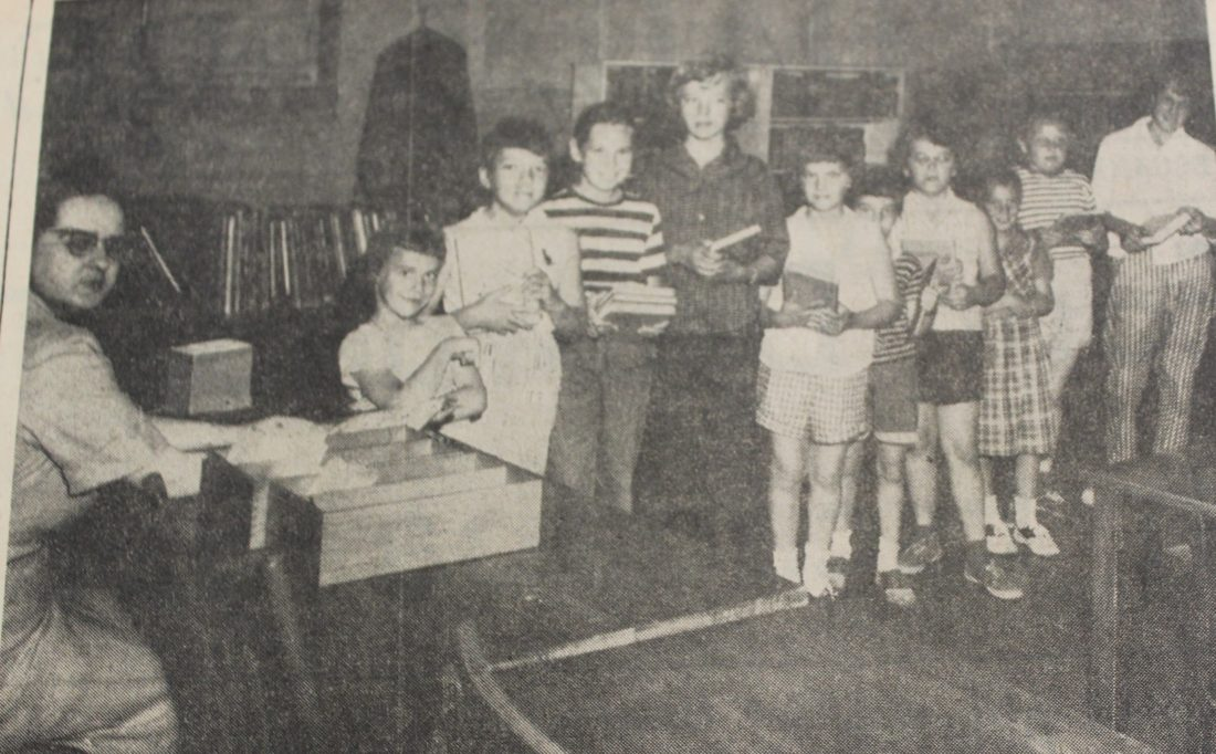 Daily Press photo There was a waiting line every Thursday afternoon when the Carnegie Public Library's north end branch in the Webster School opened for summer service in 1958. The Thursday afternoon circulation of library books, limited to children in other years, was being offered that year to children, teenagers and adults. Pictured, from left, Librarian Mrs. Kenneth Jensen, Mary Jean LaFave, Suzette Pepin, Cheryl Toushak, Patsy Elie, Darlene Gustafson, Diane LaMarch, Carol LaMarch, Lois Berube, Mary Ann LaCasse, and Margaret Anerson.