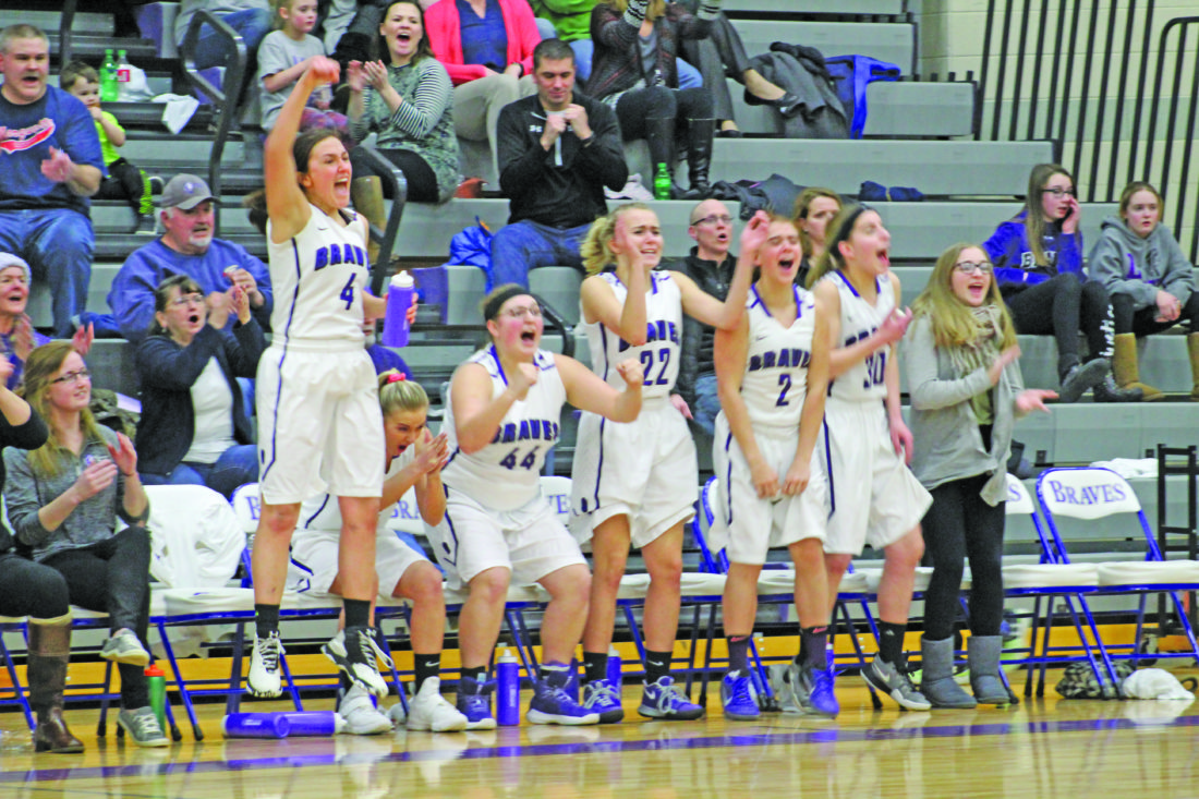 Avery Bundgaard | Daily Press  Members of the Gladstone girls' basketball team celebrate after a made shot in the fourth quarter against Escanaba Monday at Gladstone.