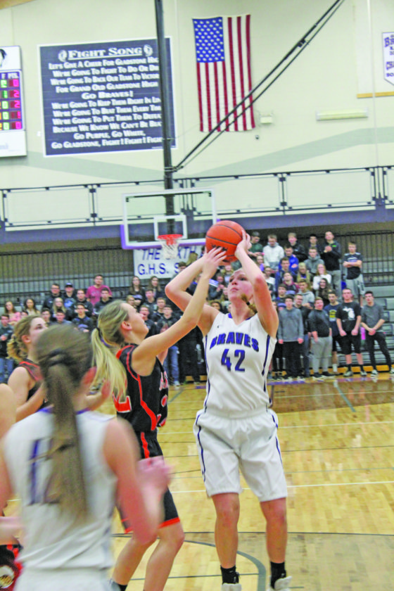Avery Bundgaard | Daily Press  Gladstone's Megan Crow (42) goes up for a shot over Escanaba's Cassidi Stannard during the first quarter Monday at Gladstone.