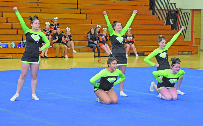 Mike Mattson | Daily Press The Manistique cheer team, shown at Saturday's Eskymo Elks Invitational, will compete in the Division 4 district tournament Friday at Houghton Lake High School. Escanaba and Gladstone will travel to Shepherd  High School for Saturday's Division 3 district.