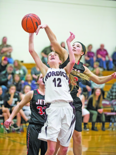 Adam Niemi | Iron Mountain Daily News  North Central's Chloe Wells (32) blocks a shot by North Dickinson's Briana Smith (12) Monday in Felch.