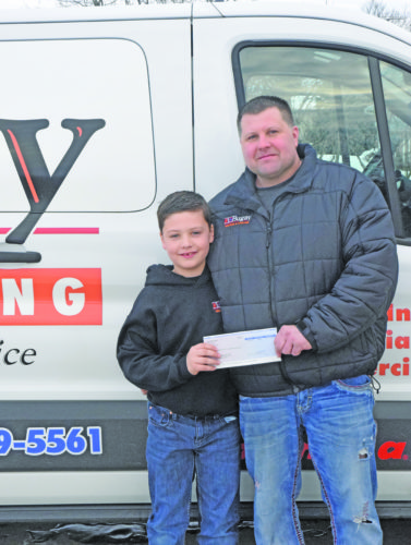 Mike Mattson | Daily Press The Bugays — Collin (left) and Rich —won The Daily Press Red Zone contest this season and designated their $250 winnings to the Delta Animal Shelter.
