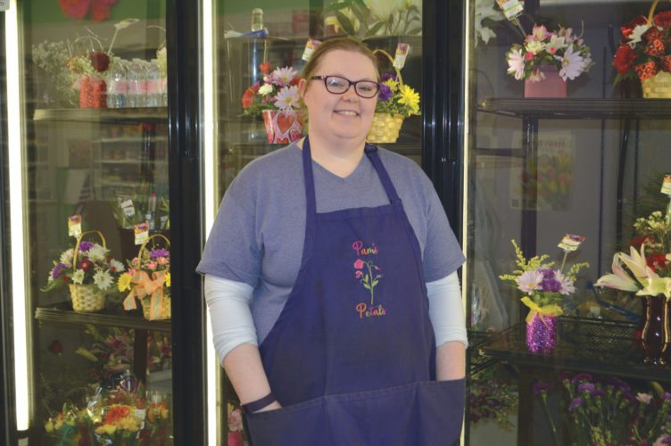 Jordan Beck | Daily Press Pam Frossard, owner of Escanaba flower shop Pam's Petals, is pictured in front of her shop's floral cooler Friday. Since it opened on Ludington Street last spring, the shop has grown into a successful new business.