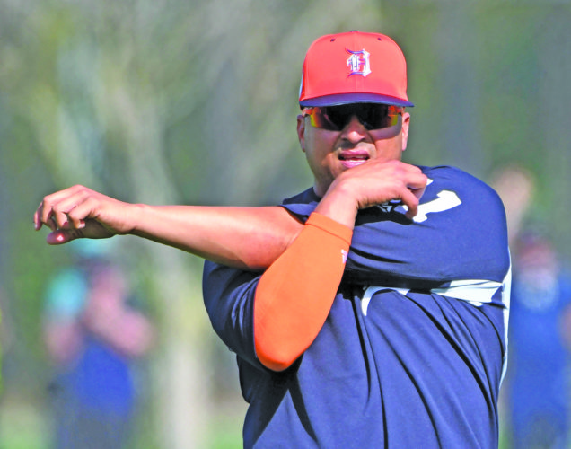 Robin Buckson   Detroit News via AP Detroit Tigers designated hitter Victor Martinez stretches during spring training baseball at the practice fields in Lakeland, Fla. on Monday.