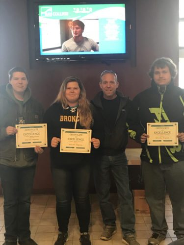 Courtesy photo Above, the three students who swept the overall automotive category at the SkillsUSA regional competition in Escanaba on Feb. 10 stand with their certificates and teacher, Eric Parrota. From left are, Taylor Frossard, of Escanaba, second place; Maggie Martin, of Bark River, third place; Parrota; and Brendan Rae, of Escanaba, first place.