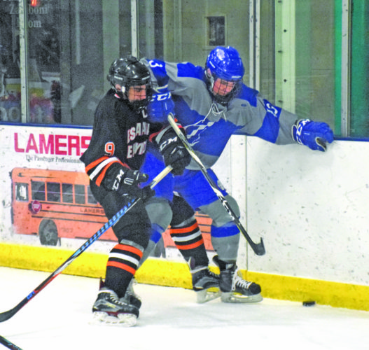 Eden Laase | Daily Mining Gazette Hayden Haslow of Escanaba and Gabriel Coppo of Calumet fight for the puck Tuesday in Calumet. The Copper Kings won 9-1.