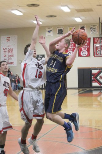 Avery Bundgaard | Daily Press Bark River-Harris' Ben Schultz (31) puts up a shot while North Central's Noah Gorzinski (12) defends during the first quarter Friday at North Central.