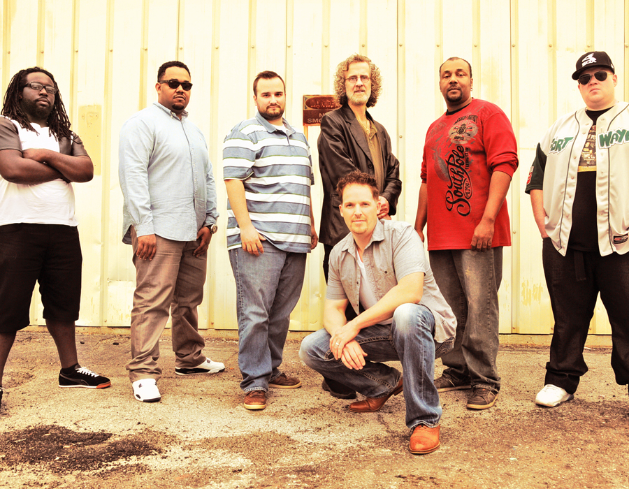 """From left: Drake Bates, Kimball Glaspie, Jason Westerman, Dave Latchaw, Will Brown, Aaron King and, in front, Tony Didier. Not pictured: Dave """"Catfish"""" Pagan, photography by Ellie Bogue"""