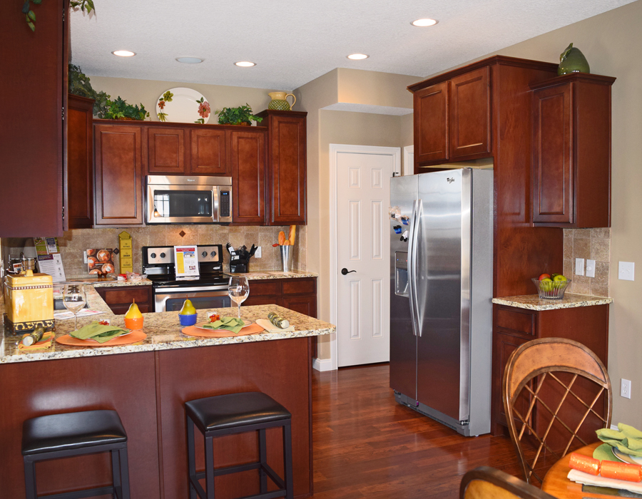 The First Floor Includes A Roomy Eat In Kitchen With Stained Maple Cabinets,  ...