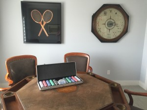 Room décor has fun with the game theme in the spare bedroom Jennifer Ford and her husband JR have turned into a game room, with vintage tennis racquets and a playing card clock on the wall.