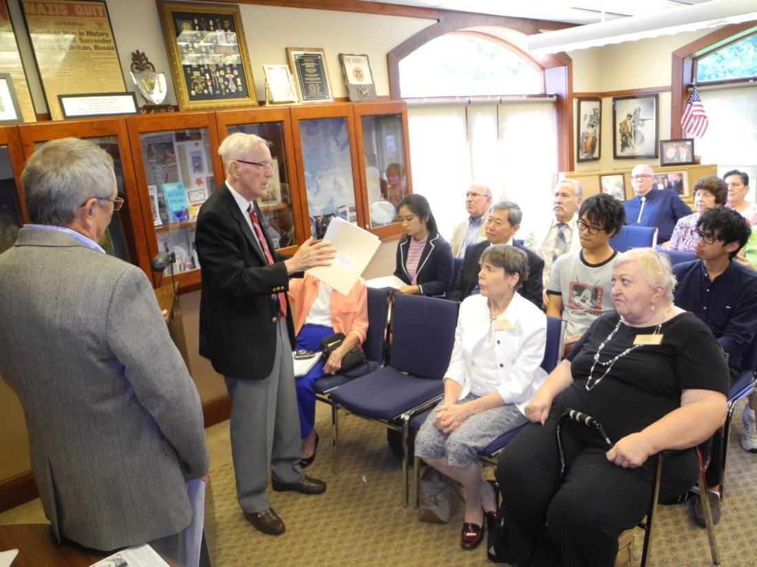 Ed Jackfert of Wellsburg related his experiences as a prisoner of war to Professor Kimio Yakushiji and several students from Ritsumeikan University in Kyoto, Japan, and others Friday during a visit to the National American Defenders of Bataan and Corregidor Museum, which Jackfert helped to launch in Wellsburg.  — Warren Scott