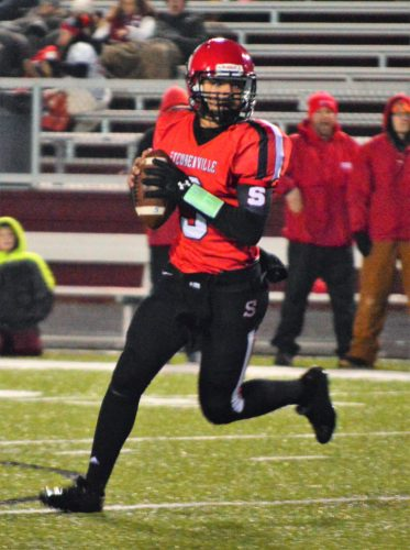 Mike Mathison LEADING THE WAY — Steubenville junior quarterback Javon Davis looks to throw a pass during the second half of the 51-27 state semifinal win over Perry at Boardman High School. Davis has helped lead Big Red to the Division IV state title game 21 years after his father Jose did the same thing for Bellaire.