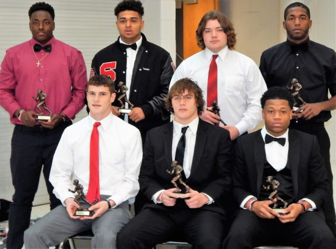 Ed Looman AWARD WINNERS — Big Red held its 76th annual football banquet Sunday, saluting the 2016 team for its accomplishments, a 13-2 record and the Ohio Division IV runner-up. Numerous awards also were presented. Those receiving major awards were, front, from left, Nick Scott, Zane Zimish and Pookie Petteway; back, Ny'Juan Robinson, Drone Moore, Mark Smith and Jalen McGhee.