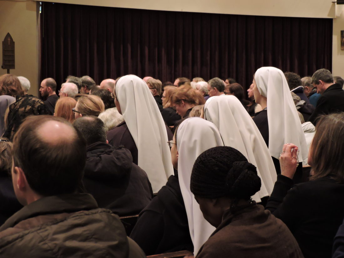 """Remembering the Rev. Michael Scanlan, TOR Franciscan friars and mourners filled the Christ the King Chapel on the Franciscan University of Steubenville campus Tuesday evening for prayers and the viewing of the late priest credited with saving the College of Steubenville. The Franciscan Third Order Regular friars accompanied the casket into the chapel singing, """"Jesus, Remember me when you come into your kingdom"""" before they were joined by the mourners waiting in the lobby. The 85-year-old Scanlan died Saturday following an extended illness. A Memorial Mass is set for this morning at the Finnegan Fieldhouse. A viewing is scheduled from 4 p.m. to 7 p.m. and a vigil service at 7 p.m. today at the St. Francis Friary in Loretto, Pa. A Mass of Christian Burial will be celebrated at 11 a.m. Thursday in the Chapel of the Immaculate Conception at St. Francis University in Loretto. - Dave Gossett"""