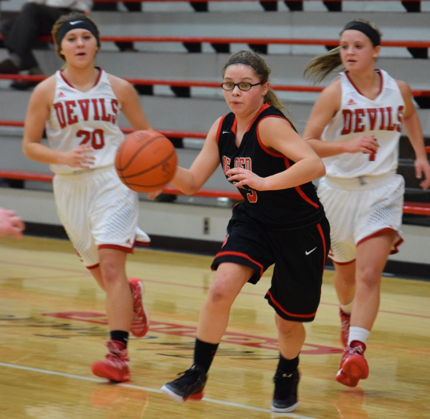 ON THE MOVE — Steubenville's Seana Ragusa drives toward the basket during Wednesday night's game against St. Clairsville. Ragusa finished with 12 points, but Big Red fell, 52-38. (Rick Thorp)