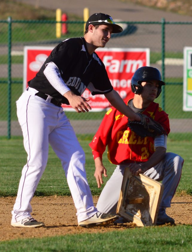 INTHEFIELD — Edison's Joey Nave keeps the tag on Indian Creek's Austin Rawson after Rawson stole second base in the fifth inning of 12-1 Edison victory. (Mike Mathison)