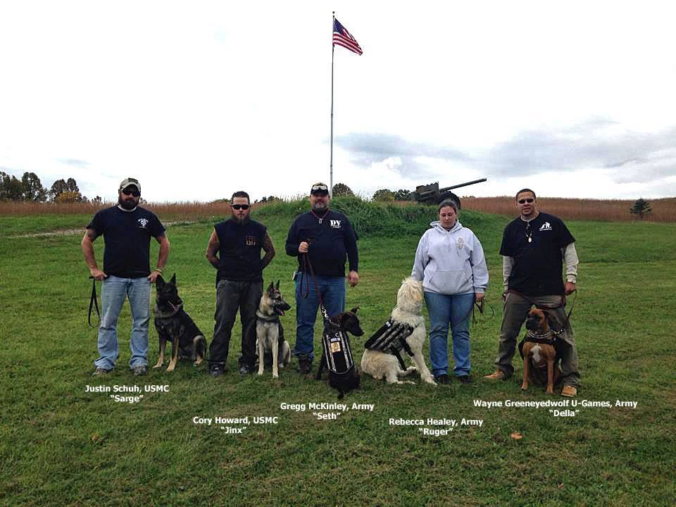SUCCESSFULMATCHES — The Dogs 4 Warriors program works with the prison system in Belmont County to provide trained service dogs to veterans across the country. Some of the successful placements, from left, include Justin Schuh, Marine Corps, with Sarge; Cory Howard, Marine, with Jinx; Gregg McKinley, Army, with Seth; Rebecca Healey, Army, with Ruger; and Wayne Greeneyedwolf U-Games, Army, with Della. - contributed