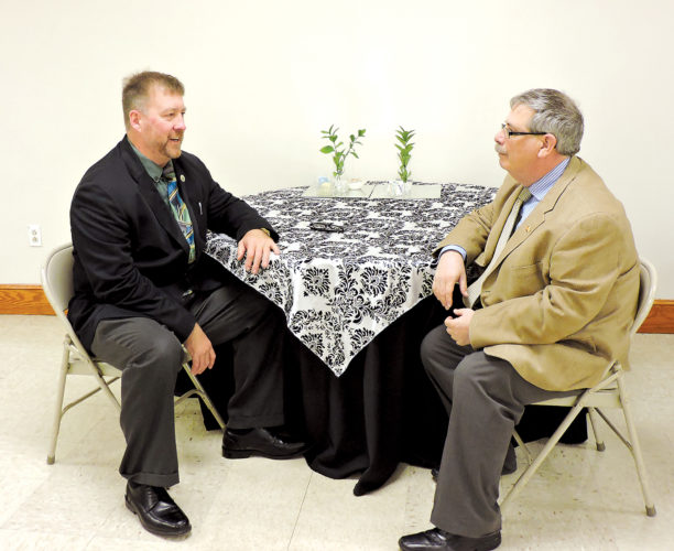SPEAKER PLANS — Mike Florak, left, executive director of community relations at the Franciscan University of Steubenville, and Ross Gallabrese, executive editor of the Herald-Star and The Weirton Daily Times, discuss the April 27 appearance by Michael Hayden as part of the Trinity Health System System Presents the Herald-Star Speaker Series. Hayden's presentation will be held at Catholic Central High School. -- Dave Gossett