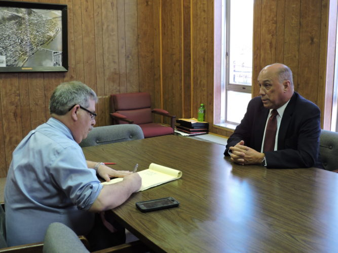 AN IMPORTANT SPEAKER — Steubenville City Manager Jim Mavromatis, right, and Ross Gallabrese, executive editor of the Herald-Star and The Weirton Daily Times, discuss the message Michael Hayden will deliver when he appears at 7:30 p.m. April 27 in Catholic Central High School as part of the Trinity Health System Presents the Herald Star Speaker Series. - Dave Gossett