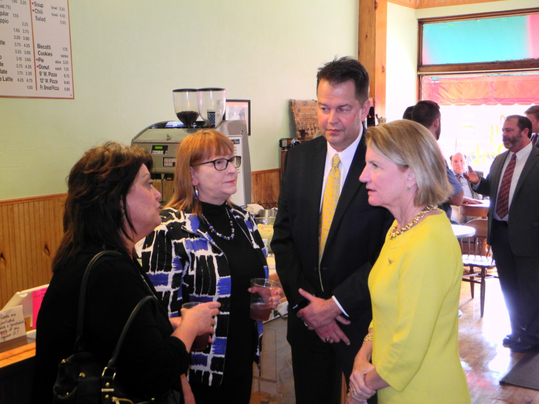 VISITS FOLLANSBEE — U.S. Sen. Shelley Moore Capito, R-W.Va., far right, chatted with local residents, business leaders and officials, during a visit to the Daily Perk coffee shop and the Follansbee City Building Wednesday. With her are Cindy Kocher, Debbie Puskarich and Mayor David Velegol Jr. - Warren Scott